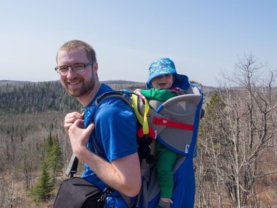 Bobby Marko carries son, Jack, during a May hike on