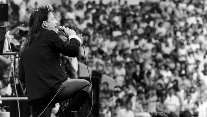 Bono performing with U2 at the Live Aid charity concert, Wembley Stadium, London, 13th July 1985
