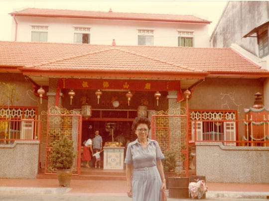 Mom, in a photo from the early 1970s, is seen in front of a Buddhist temple in Singapore.