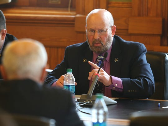 Iowa Sen. Rich Taylor of Mount Pleasant fires questions at Department of Human Services Director Charles Palmer during a hearing on Thursday at the Iowa Capitol building in Des Moines. The department is looking into closing two mental health facilities.