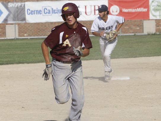 Ankeny runner Jesse Kisker races toward third base
