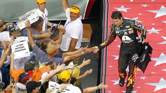 Jeff Gordon greets fans during driver introductions for the Coke Zero 400 at Daytona International Speedway.