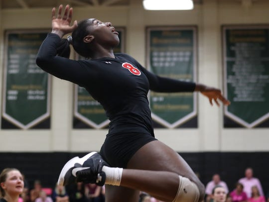 Leon's Makayla Washington leaps to spike the ball during