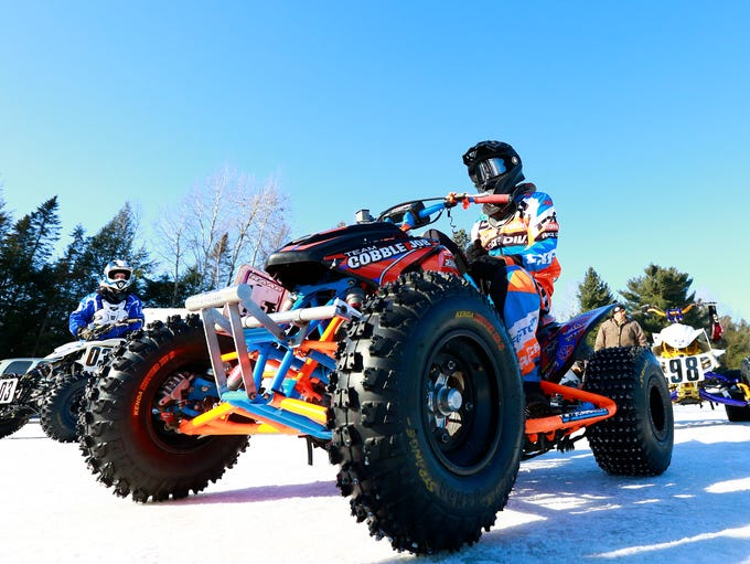 Racers line up before competing in the AMA ATV Ice