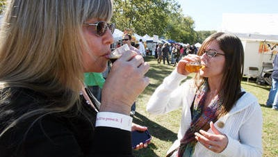 Jill Lehman of Baltimore, left, and Paula Betz of Selbyville try some brews during a previous Good Beer Festival.