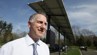 Montebello mayor Jeffrey Oppenheim by the carport covered with photovoltaic solar cells which help to power village hall April 7, 2010.