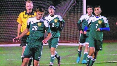 Sophomore Liam Percival (left) scored both goals for the Hawks in the 2-2 tie.
