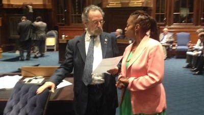 Yonkers City Council Minority Leader Michael Sabatino, left, discusses the latest budget proposal with Ivy Reeves during a council meeting recess on June 10, 2014.