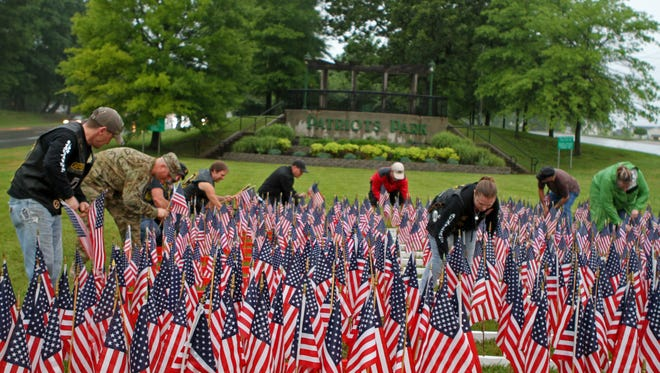 Members of Combat Veterans Motorcycle Association Chapter 18-2 placed 653 American flags at Patriots Park on Wednesday. It's their way of honoring Fort Campbell soldiers who have fallen since Sept. 11, 2001.
