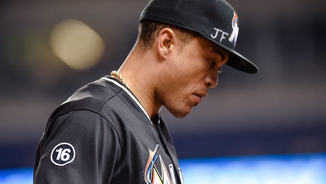 Giancarlo Stanton is seen wearing Marlins starting pitcher Jose Fernandez number on his jersey.