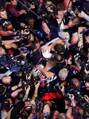Congers native Tracy Wolfson is in the scrum surrounding New England Patriots' Tom Brady after the NFL Super Bowl 53. (AP Photo/Morry Gash)