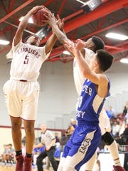 Crockett County's Javion Hannah pulls down a rebound Monday night against Chester County.