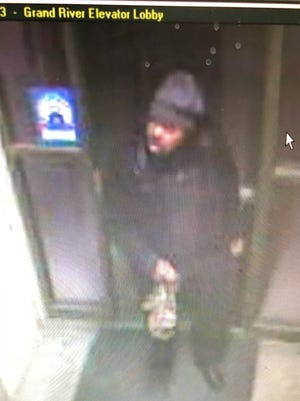 Detroit police are searching for a man who robbed and assaulted a woman at a parking garage on Monday.