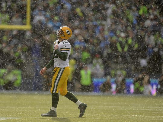 Green Bay Packers quarterback Aaron Rodgers reacts after throwing an interception against the Seattle Seahawks during the NFC championship game at CenturyLink Field.