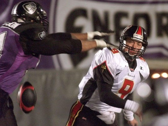 San Francisco Demon quarterback Mike Pawlawski, right, has his pass knocked down by Chicago Enforcers' Hubert Thompson in the second quarter of a XFL game at Soldier Field in Chicago on March 18, 2001.