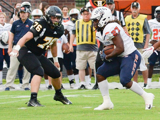 Blackman High School player Ta'micus Napier (27) makes