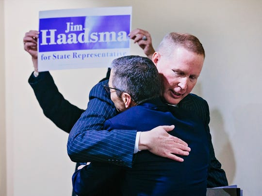 Former congressman Mark Schauer and longtime county Commissioner Jim Haadsma embrace as Haadsma officially announces his candidacy for the 62nd state House District.
