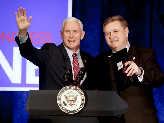 Vice President Mike Pence, left, stands with PA State
