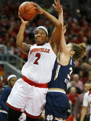 Louisville's Myishas Hines-Allen gets a shot off against Notre Dame's Kathryn Westbeld before foulding out of the game. Feb. 7, 2016.