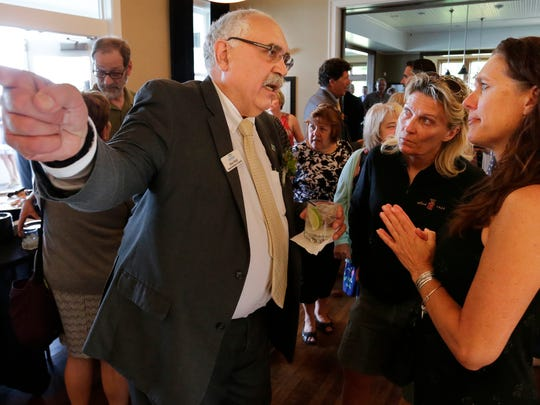 Stan Mack talks with Cindy Suess and Julie Duke during the retirement reception.  The Oshkosh community turned out to give their well wishes to Stan Mack as he retires from Superintendent of the Oshkosh Area School District.  He led the district for six years.  His retirement party was held at the Water's, June 14, 2018.  