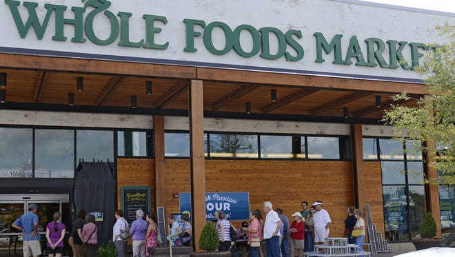 Visitors lined up to get a peek inside the new Whole Foods Market on Friday.
