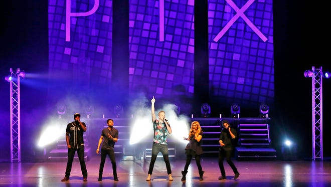 The popular a cappella group Pentatonix perform Wednesday, October 1, 2014, at Elliott Hall of Music on the campus of Purdue University. Band members are Kevin Olusola, from left, Mitch Grassi, Kirstie Maldonado, Scott Hoying and Avi Kaplan.