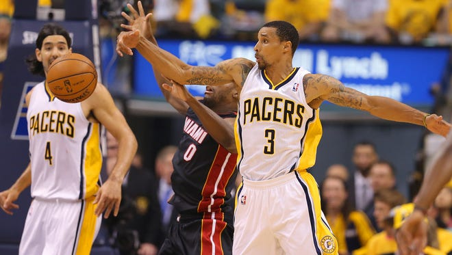 Indiana Pacers George Hill (3) and Miami Heats Toney Douglas (0) battle for the ball during the second half of action. The Indiana Pacers hosted the Miami Heat in Game 5 of the NBA Eastern Conference Finals Wednesday, May 28, 2014, at Bankers Life Fieldhouse in Indianapolis.