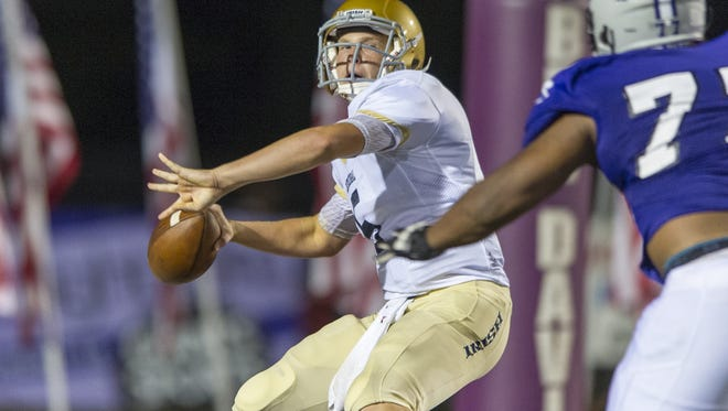 Cathedral High School junior Max Bortenschlager (5)  drops back to pass during the second half of action at Ben Davis High School, Friday, August 22, 2014. Ben Davis High School hosted Cathedral High School in varsity football action. Ben Davis won the season opener over Cathedral 44-19.