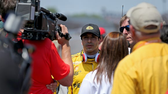 Helio Castroneves wears the headphones as often as possible when in the spotlight.