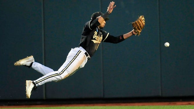 Vanderbilt's John Norwood misses a fly ball in the sixth inning Tuesday.