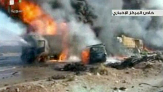 This image made from video from Syrian state television shows the aftermath of a truck bomb attack in Hama, Syria, on Oct. 20.