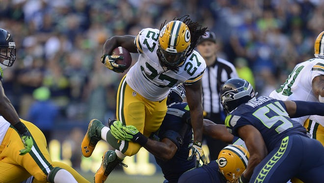 Green Bay Packers running back Eddie Lacy (27) leaps over the line while making a run against the Seattle Seahawks at CenturyLink Field in Seattle, Wash., on Thursday, Sept. 4, 2014. Evan Siegle/Press-Gazette Media