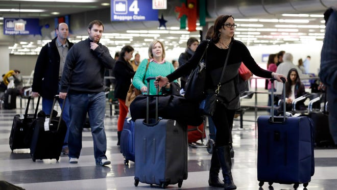 Think before you pack: With airline luggage fees, bringing gifts home for the holidays can be costly.
