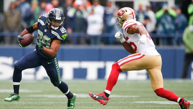 Seattle Seahawks wide receiver runs after the catch against San Francisco 49ers cornerback Dontae Johnson in the first quarter of last Sunday's game at CenturyLink Field in Seattle, Washington.