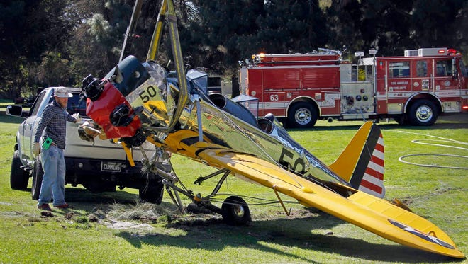The World War II-era trainer airplane that Harrison Ford crash-landed Thursday is removed from Penmar Golf Course in the Venice area of Los Angeles on March 6.