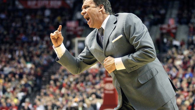 In this file photo, longtime NBA coach Flip Saunders shouts at an official during a game.