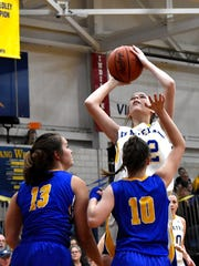 Carly Scott (32) eyes an inside jumper for Madeira