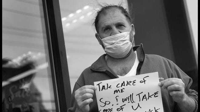 "Fuad Atche, 48, of Fair Lawn, a security officer, shares his message on the coronavirus crisis on May 5th, 2020: "" Take care of me. So I will take care of U. Wear a mask."""