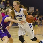 Marlea Nolan drives toward the basket while being guarded by a Catholic Central defender in December of 2014. Nolan will continue her basketball career at Mansfield University.