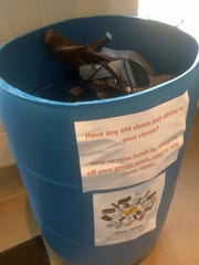 Heels and other shoes fill a drop-off bin inside the entrance for the Bay Area Humane Society in Green Bay on Thursday, Oct. 27, 2016. The humane society is accepting donated pairs of shoes until Nov. 5 as a way to raise money that will help with the care of the animals at the shelter through an exchange with the Funds2Orgs network.