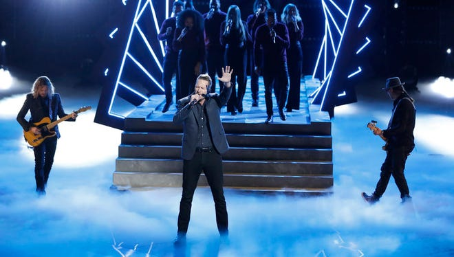 """""""The Voice"""" contender Barrett Baber sang on a recent episode of the show, in front of a scenic element similar to the High Trestle Trail Bridge in Boone County."""