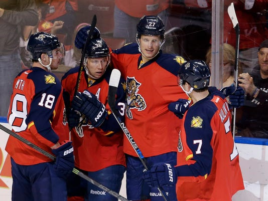 Florida Panthers left wing Jussi Jokinen (36) is congratulated by teammates afters coring a goal against the Carolina Hurricanes during the first period of an NHL hockey game, Saturday, April 9, 2016, in Sunrise, Fla. (AP Photo/Alan Diaz)