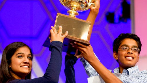 FILE - In this May 28, 2015, file photo, Vanya Shivashankar, 13, left, of Olathe, Kan., left, and Gokul Venkatachalam, 14, of St. Louis, hold up the trophy as co-champions after winning the finals of the Scripps National Spelling Bee in Oxon Hill, Md. The Scripps National Spelling Bee is adding a new wrinkle in 2017 in yet another attempt to stop a streak of ties for the championship. This year, the top spellers will sit for a written tiebreaker test before they begin spelling words in the primetime finale. The results will be revealed only if two or three spellers get through the final rounds unscathed.