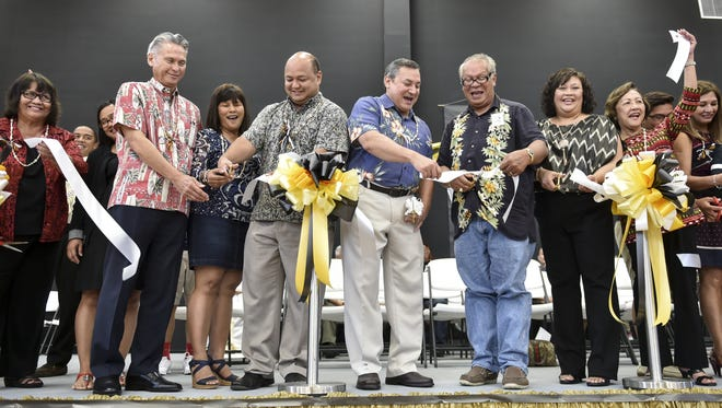 School officials and community leaders, including Gov. Eddie Calvo and Superintendent John Fernandez, cut the ceremonial ribbon to open the new Tiyan High School gym on Dec. 18.