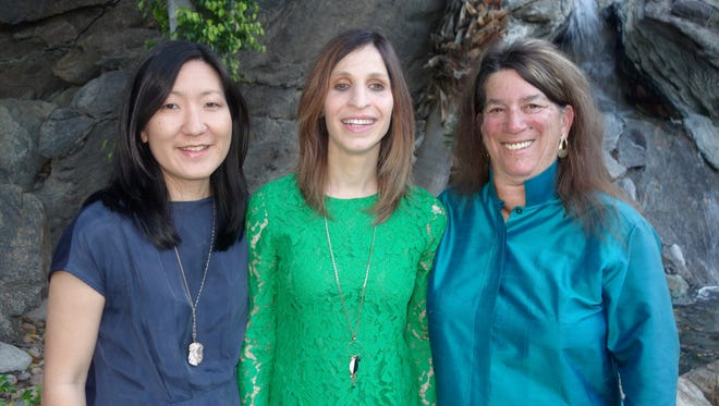 Performer Laurie Gale Rubin (center) and wife Jennifer Taira (left) with OperaArts President Arlene Rosenthal