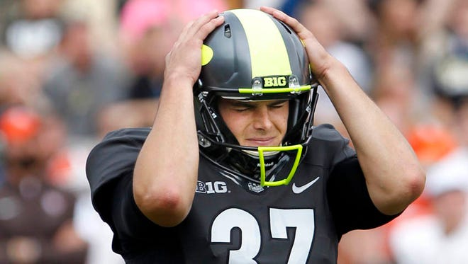 Purdue place kicker Paul Griggs reacts after missing a 32 yard field goal with less than three minutes remaining against Bowling Green in an NCAA college football game Saturday, Sept. 26, 2015, in West Lafayette, Ind.
