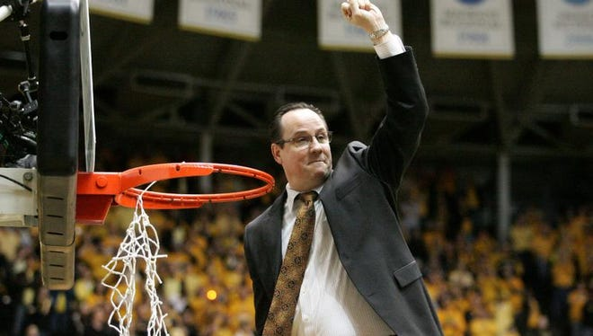Wichita State Shockers head coach Gregg Marshall celebrates Feb. 22 after cutting off part of the net following an 83-54 win against the Drake Bulldogs at Charles Koch Arena. The win gave the Shockers the Missouri Valley Conference regular season championship.
