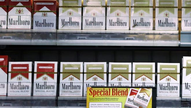 Marlboro Gold and other Marlboro varieties of cigarettes are displayed in a Little Rock, Ark., store on Oct. 23.
