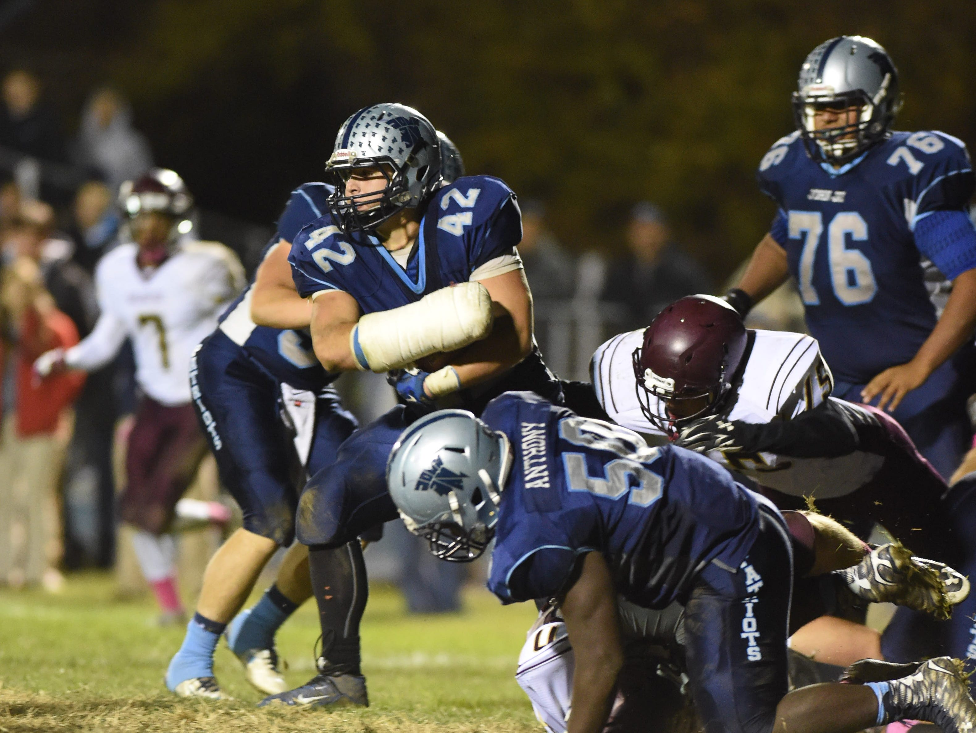 John Jay's Frank DiFusco carries the ball through Arlington's defense during Friday's game in Wiccopee.