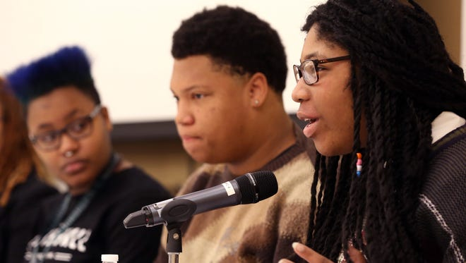 Kristen Oguno, right, participates in a panel discussion on creating social change at the Nashville Public Library on Saturday Jan. 16, 2016.